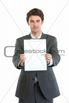 Modern businessman showing blank clipboard