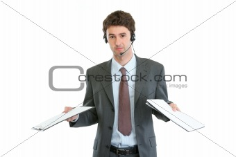 Business operator with headset confused in pile documents