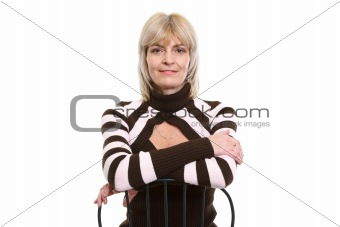 Portrait of middle age woman sitting on chair
