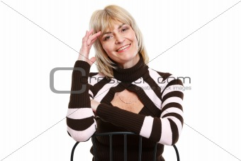 Portrait of smiling senior woman sitting on chair