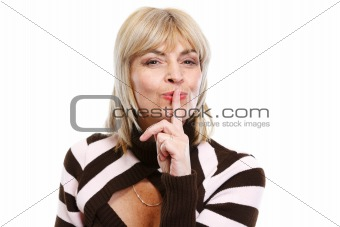 Senior woman showing shh gesture