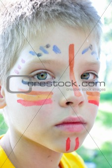 boy with football paintings on face