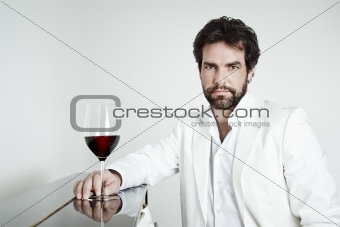 handsome man and a glass of red wine