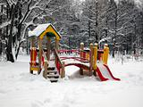 Children's playground in winter