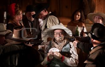 Happy Gambler Holds Winning Cards