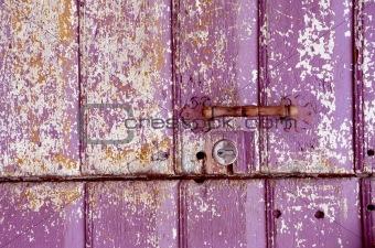 Old painted, crumbled door.