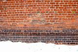 Backdrop of grunge red brick wall and snow winter