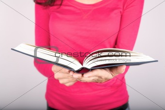 pink lady holding book