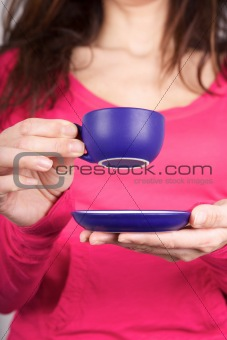 pink sweater woman drinking coffe