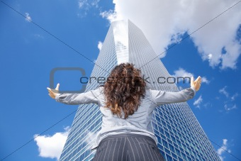 woman adoring crystal skyscraper