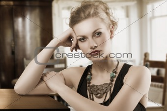 blond woman with necklace