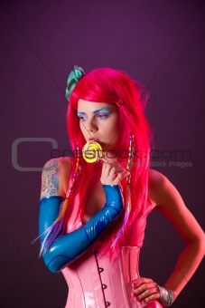 Bright girl with pink hair holding lollipop