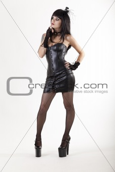 Full length shot of fetish woman in sexy outfit