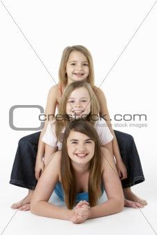 Three Girls laying On Stomach In Studio