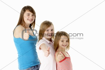 Three Girls Giving Thumbs Up Gesture In Studio