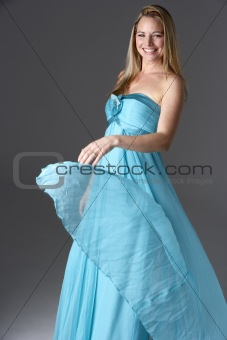 Full Length Studio Shot Of Young Woman In Blue Evening Dress