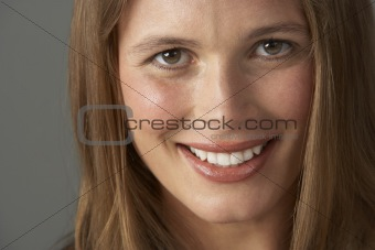Close Up Studio Portrait Of Smiling Young Woman