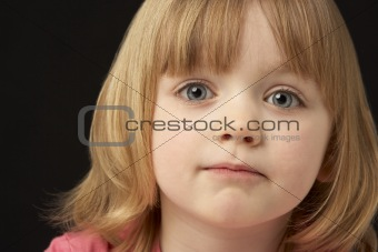 Close Up Studio Portrait Of Sad Young Girl