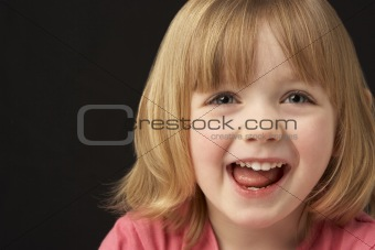 Close Up Studio Portrait Of Smiling Young Girl