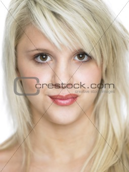 Close Studio Portrait Of Blonde Teenage Girl