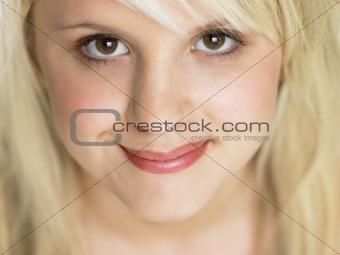 Close Studio Portrait Of Blonde Teenage Girl
