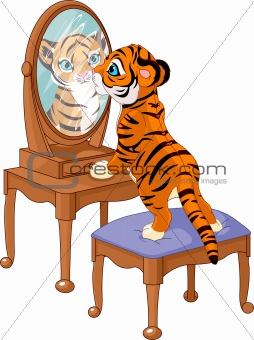 Tiger cub looking in the mirror