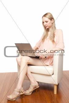 Portrait of young beautiful smiling woman with laptop