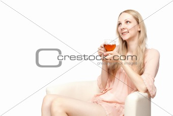 Beautiful young woman drinking tea sitting