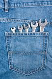 Blue jeans pocket with wrenches