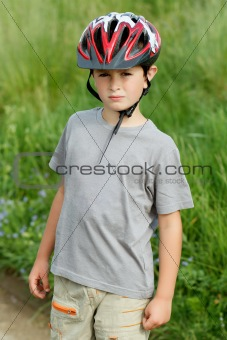 portrait of boy bicyclist with helmet