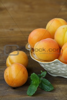 Group ripe juicy fruit apricot on a wooden table, rustic style