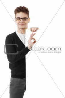 Young man with a blank baner