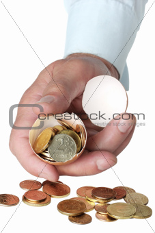 Coins in broken eggshell, in hand