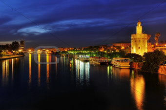Guadalquivir River and the Torre del Oro, in Seville, Spain at night