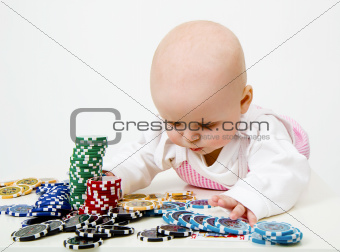 Baby playing poker chips