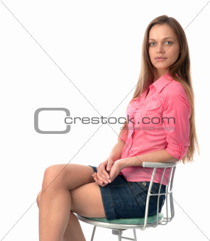 young young woman sitting on a chair