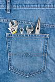 Several tools on a jeans pocket