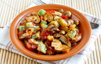 Roasted vegetables on a rustic plate