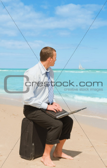 businessman  on the beach