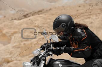 A motorcyclist in a desert