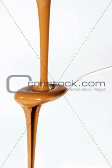 Liquid chocolate on spoon