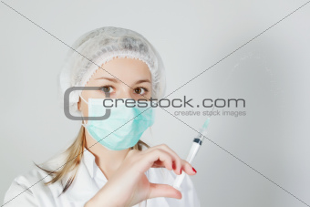 A nurse with a prick and a mask.