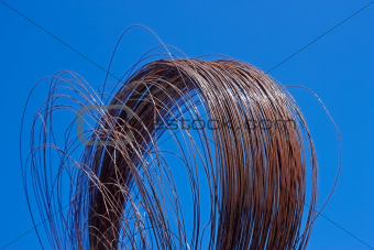 Rusty wire against blue sky