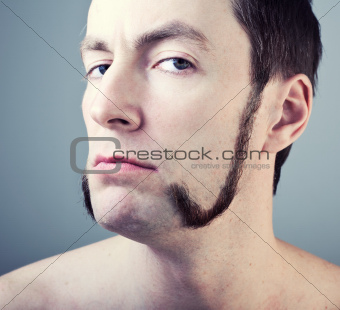 man with sideburns