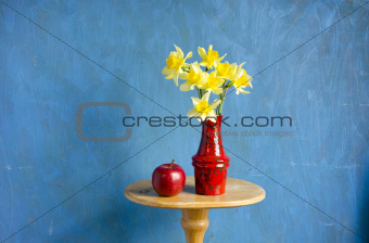 vase with narcissus and red apple