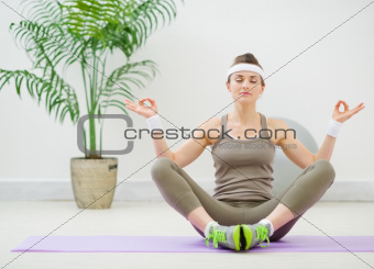Healthy young woman meditating