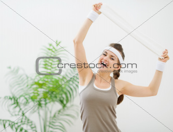 Portrait of happy fitness woman with towel