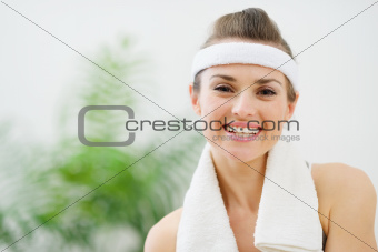 Portrait of smiling fitness woman with towel