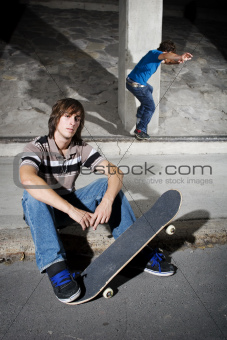 Skateboarders in underground parking lot