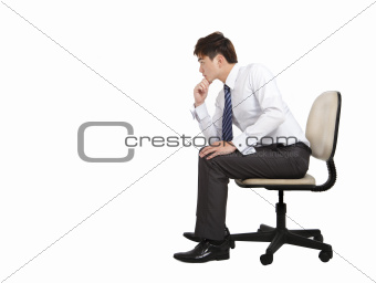 businessman thinking and sitting on the office chair